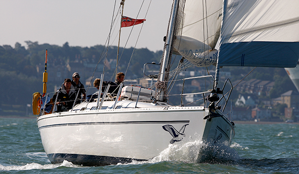 Yacht with reefed sail and yacht with reefed sail with topping lift